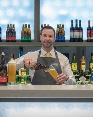 Barman serving beer at Maldron Belfast City
